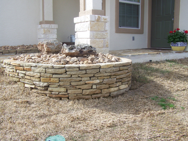 Flower bed borders hicks fencing hicks fencing for Flower bed edging stone